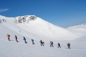 Guidet skitur i fjellene rundt Oppdal i Trøndelag, Foto: Sigbjørn Frengen