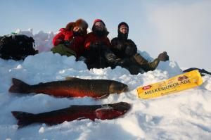Isfiske med guide på Oppdal i Trøndelag kan være en idyllisk opplevelse, Foto: Sigbjørn Frengen